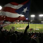 SAN JUAN, PUERTO RICO - MARCH 10:  A fan waves the Puerto Rican flag before  the game against Cuba at the World Baseball Classic at Hiram Bithorn Stadium on March 10, 2006 in San Juan, Puerto Rico.  (Photo by Al Bello/Getty Images)